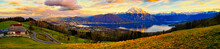 Panoramic Shot Of Land And Mountains Against Sky During Autumn