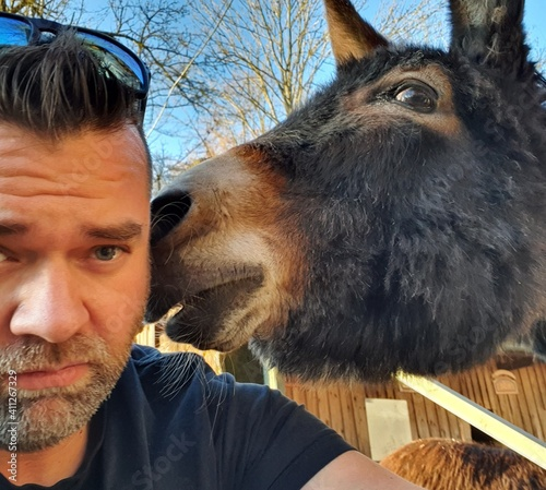 Canvas Print Close-up Portrait Of Man With Donkey