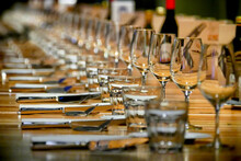 Selective Focus Shot Of Long Row Restaurant Table Setting Perspective View