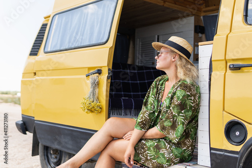 Canvas-taulu Young blonde woman travelling by campervan at the seaside