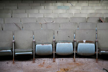 Rows Of Decaying Seats Inside An Empty Abandoned Theater