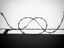 Silhouette Of Barbed Wire Against Sky