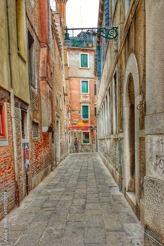 Fototapety, obrazy: Street Amidst Buildings In City