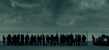 Refugees And Immigrants Looking For A New Life Expectancy. Column Of Migrants Near The State Borders. Fence And Barbed Wire. Surveillance, Supervised. Abandon Their Lands For A Better Future.