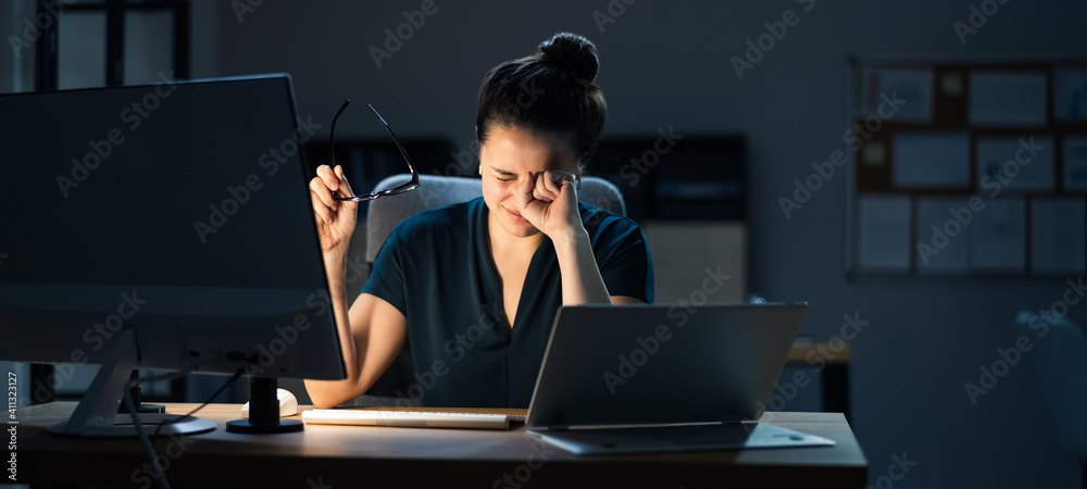 Fototapeta Woman With Dry Tired Eyes Working Late At Night