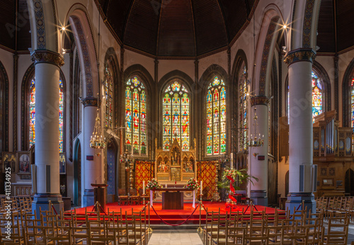 BRUGES, BELGIUM - JUNE 13, 2014: Nave and presbytery of Saint Giles gothic church (Sint Gilliskerk).