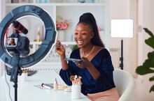 Happy Young African American Woman Streaming A Beauty Vlog From Home, Online Content Creator Applying A Makeup On