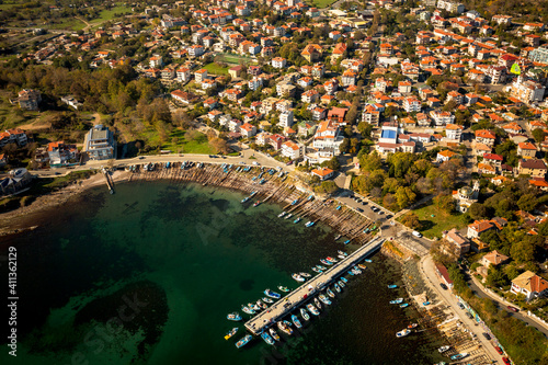 Fotografie, Tablou Aerial View Of Harbor By City During Sunny Day