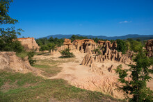 Landscape Photo Of Sandstone Pillars With Blue Sky At Sao Din Na Noi, Sri Nan National Park, Nan Province, Thailand.