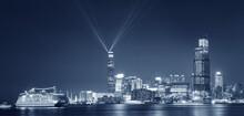 Laser Show In Victoria Harbor Of Hong Kong City At Night