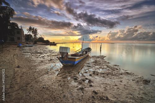 Fotomural Boat Moored On Beach Against Sky During Sunset
