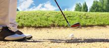 Golf Shot From Sand Bunker Golfer Hitting Ball From Hazard.