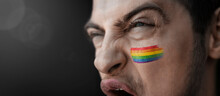 A Screaming Man With The Image Of The Lgbt National Flag On His Face