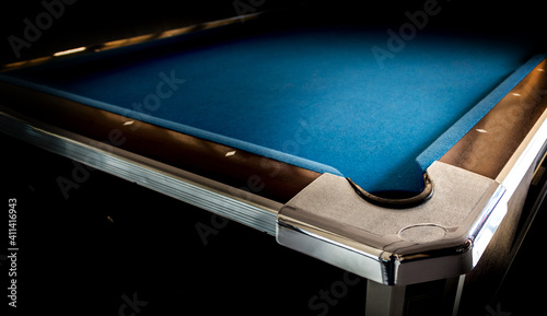 Photo hole of pool table in dark room for game