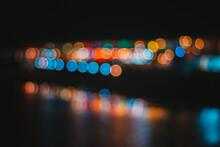 Defocused Image Of Illuminated Lights On Street