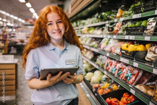 Obraz na płótnie Young worker working in a supermarket