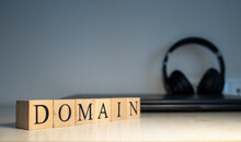 The Word Domain Is Written. Computer And Headset Concept On The Background.