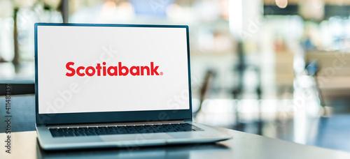Fototapeta premium Laptop computer displaying logo of The Bank of Nova Scotia