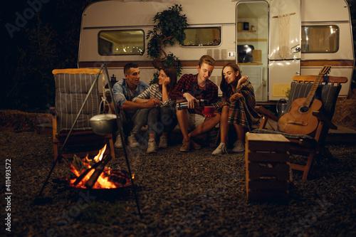 Slika na platnu Friends sitting by campfire in the night, camping