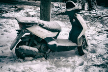 Abandoned Scooter After A Snowstorm.