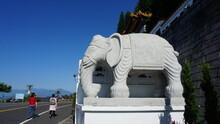 Two Hikers And An Elephant Statue At The Xuan Zang Temple, Sun Moon Lake, Yuchi Township, Nantou County, Taiwan, January
