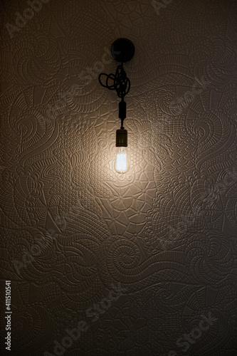 Fototapeta wall lamp with textured white wallpaper obraz