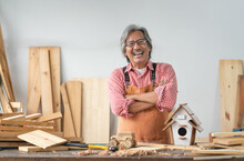 Asian Senior Carpenter Man With Crossed Arms Smile At Home Carpentry Workshop