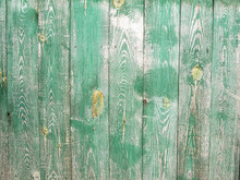 Old Shabby Green Fence. The Texture Of The Wood Fence.