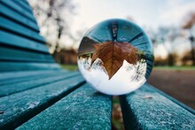 Close-up Of Crystal Ball On Wooden Frozen Bench
