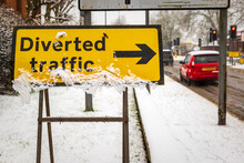 Diverted Traffic Sign Under Winter Snow Fall In England Uk