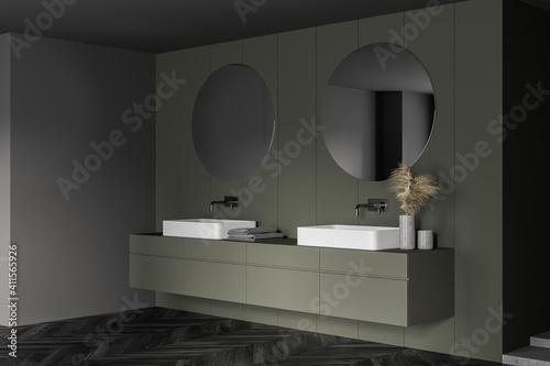 Fototapeta Grey and green bathroom with two sinks and mirrors, parquet floor obraz na płótnie
