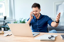 Man Argue On The Phone Working At Home Office