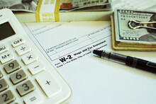 W-2 Tax Form With Fine Point Pen, Money And Calculator High Quality