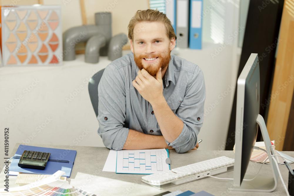 Fototapeta happy designer in his workshop