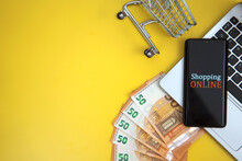 Mobile Phone, Shopping Cart And Money. Online Shopping Concept.