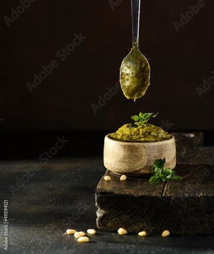 Photo pesto sauce with basil, pine nuts and garlic