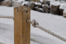 Wooden Post. Knot. Marine Rope. Knot On The Rope. Rope.