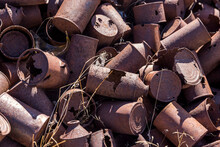 Close Up Of Rusty Pile Of Old Food And Oil Cans From A Mining Claim In The Desert