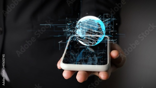 Human hand holding mobile phone with earth globe holographic technology . Futuristic visualization for virtual reality and augmented reality .