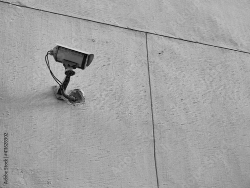 Fototapeta Low Angle View Of Security Camera On Wall
