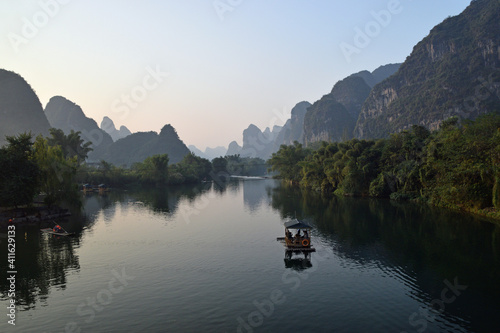 Fotografie, Obraz Scenic View Of River And Mountains Against Sky