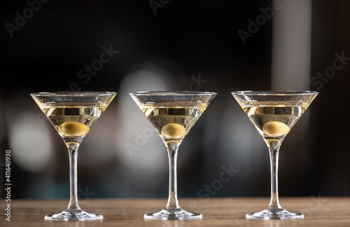 Dry Martini short drink cocktail with gin, dry vermouth and an olive garnish © weyo