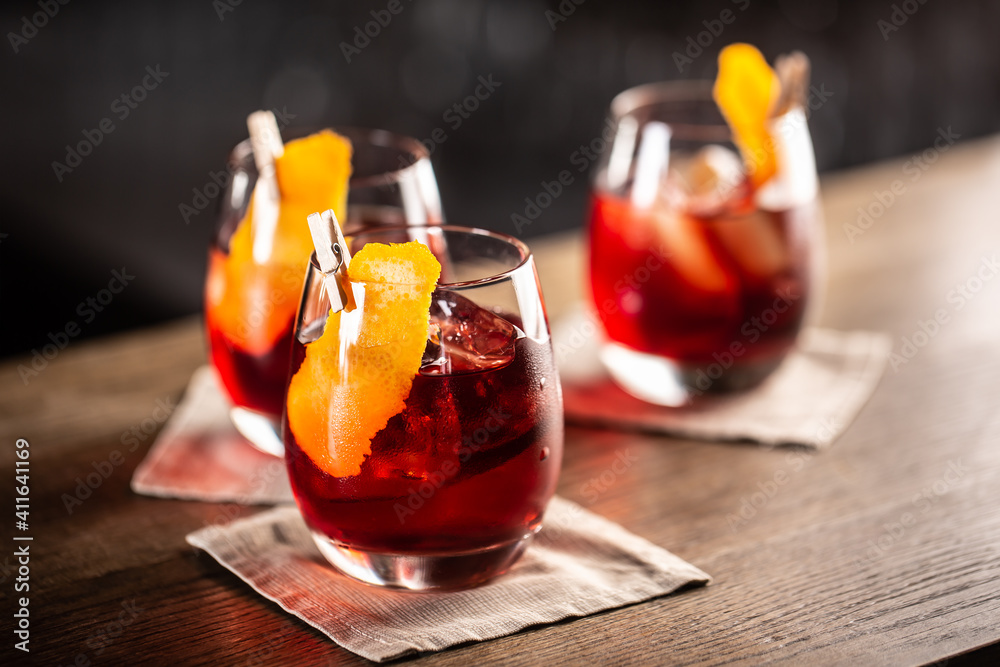 Fototapeta Negroni classic cocktail and gin short drink with sweet vermouth, red bitter liqueur and dried orange garnish
