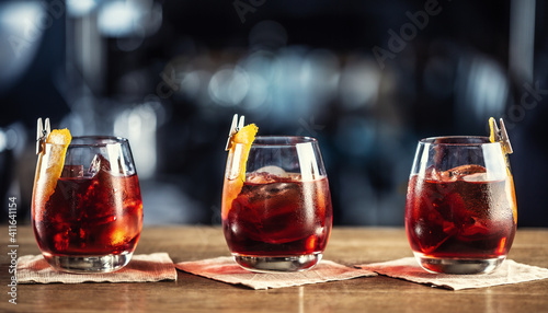 Fototapeta Negroni classic cocktail and gin short drink with sweet vermouth, red bitter liqueur and dried orange garnish obraz