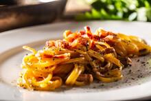 Plated Italian Spaghetti Carbonara With Ham On Top