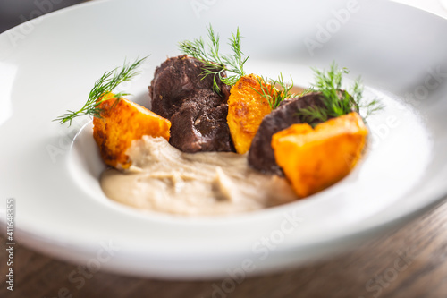 Cooked pork jowl or oxcheek served with mashed celery and baked sweet potatoes Fototapeta