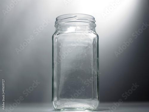 Obraz na plátně Close-up Of Empty Glass Jar Against Gray Wall