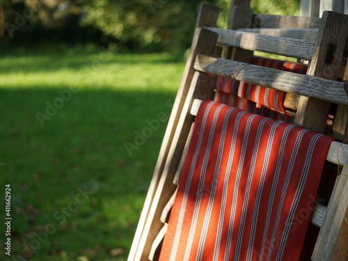 Fotografiet Close-up Of Closed Deck Chairs In Park