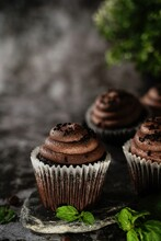 Chocolate Cupcakes On Dark Moody Background, Selective Focus