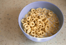 Delicious Crunchy Cereal Loops In Blue Bowl On The Table. Healthy, Low-carb, Gluten Free Breakfast